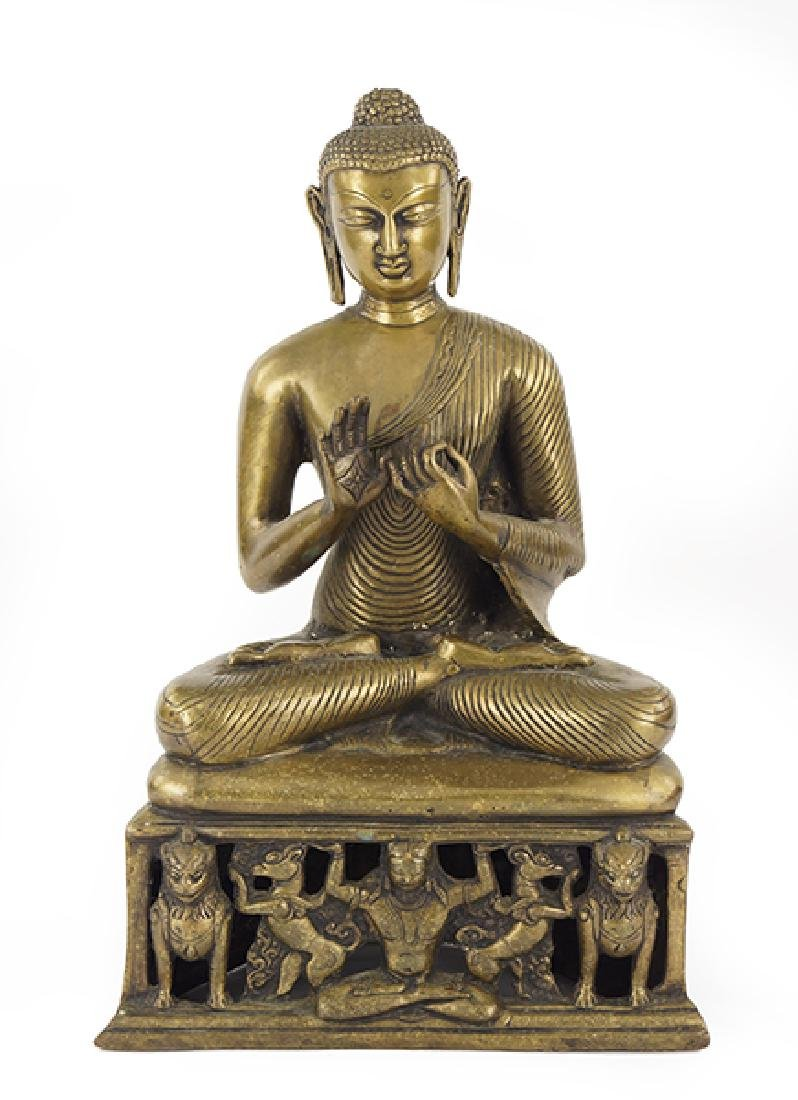 A Chinese Patinated Metal Seated Buddha Figure.