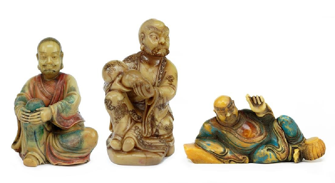 Three Chinese Carved Soapstone Figures.