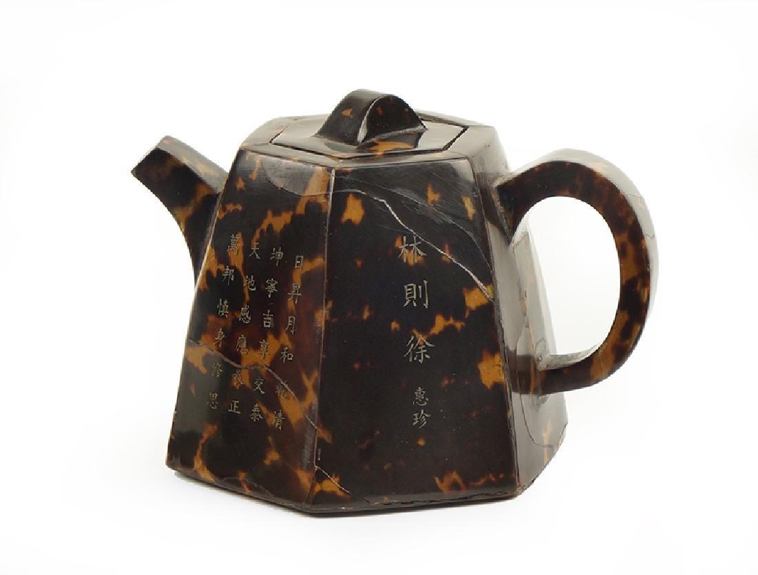 A Chinese Tortoiseshell Teapot.