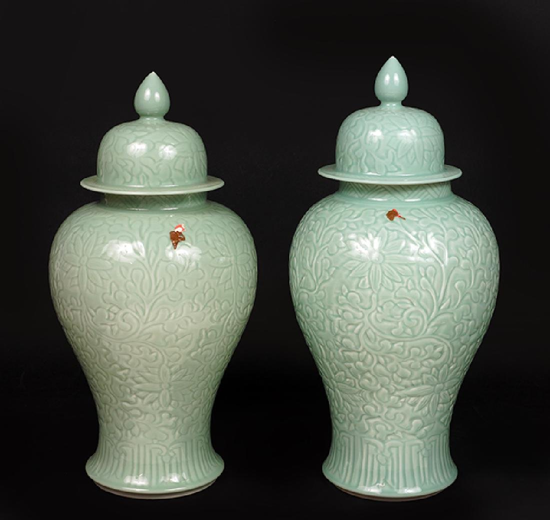 A Pair Of Chinese Celadon Porcelain Lidded Vases.