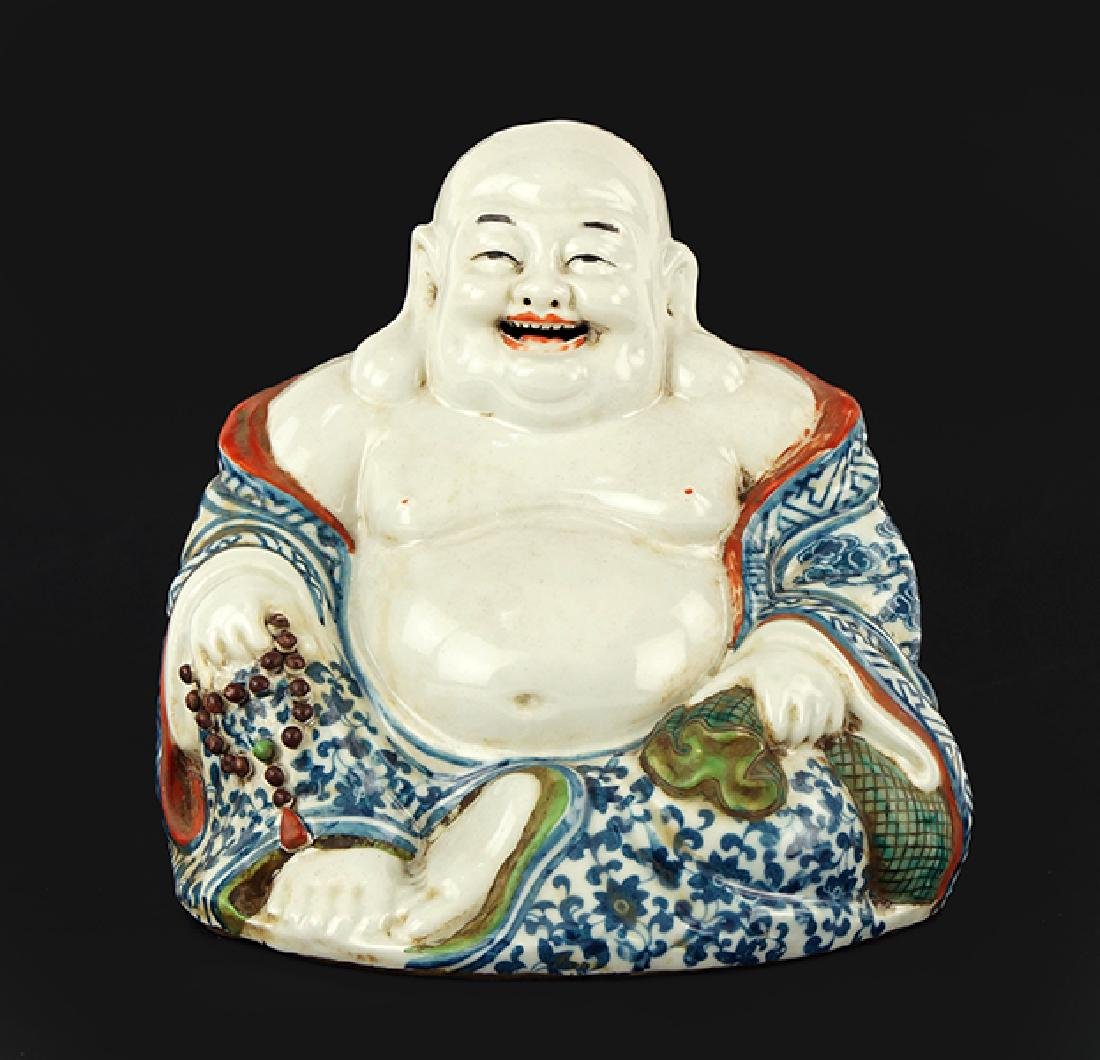 A Chinese Porcelain Seated Laughing Buddha Figure.