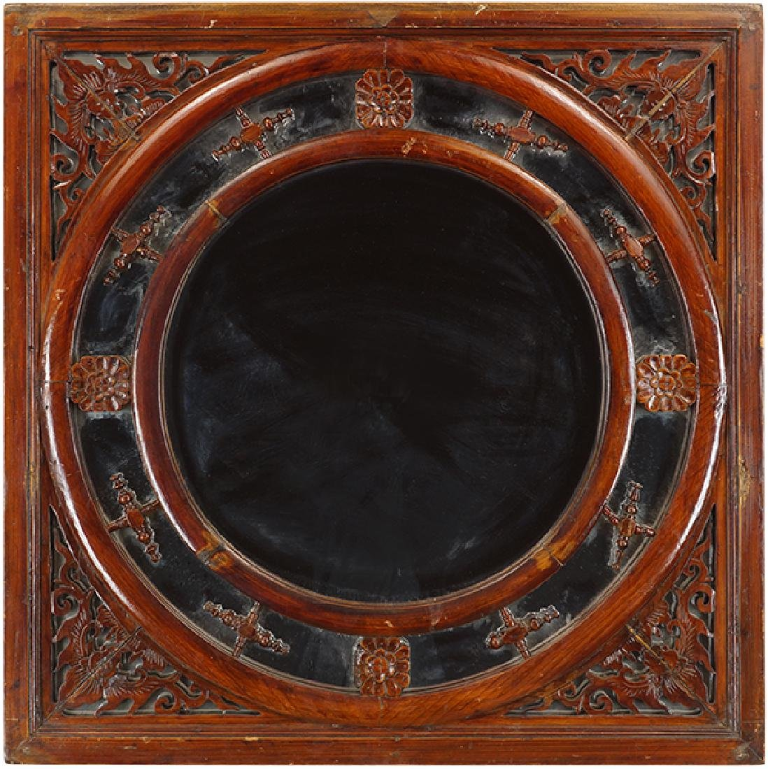 A Chinese Carved Wood Mirror.