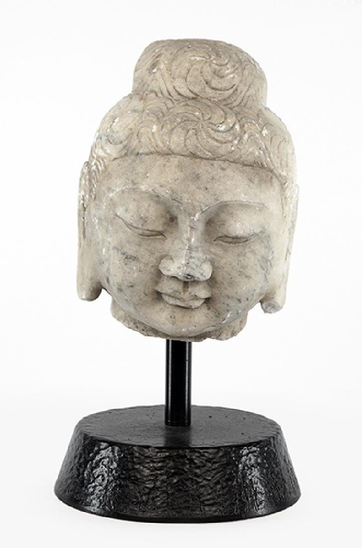 A Chinese Carved Stone Buddha Head.