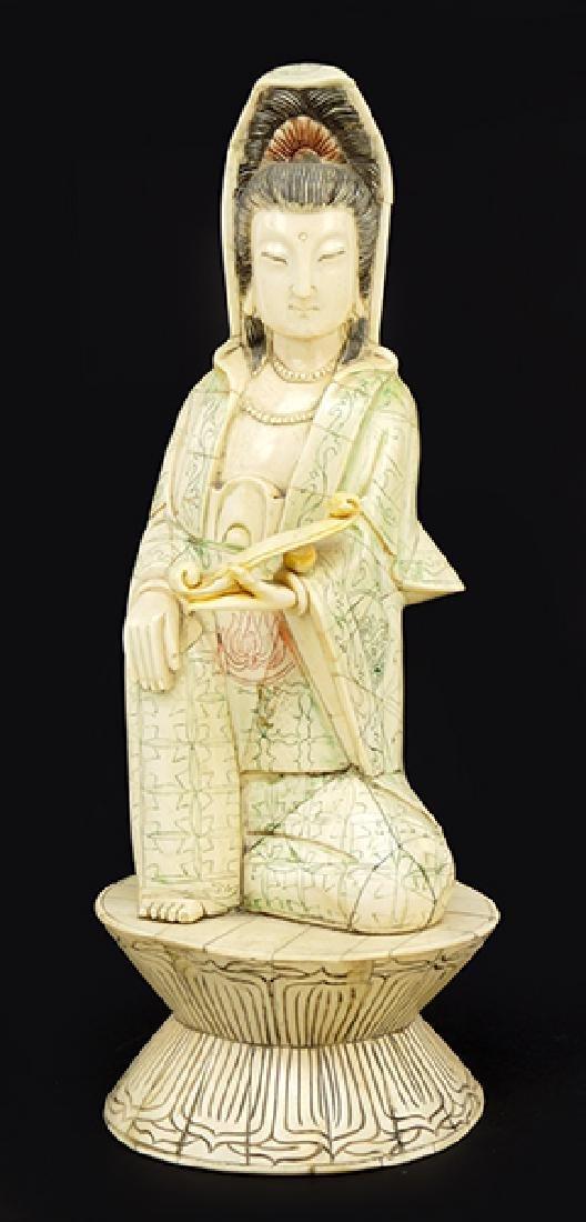 A Guan Yin Figure.