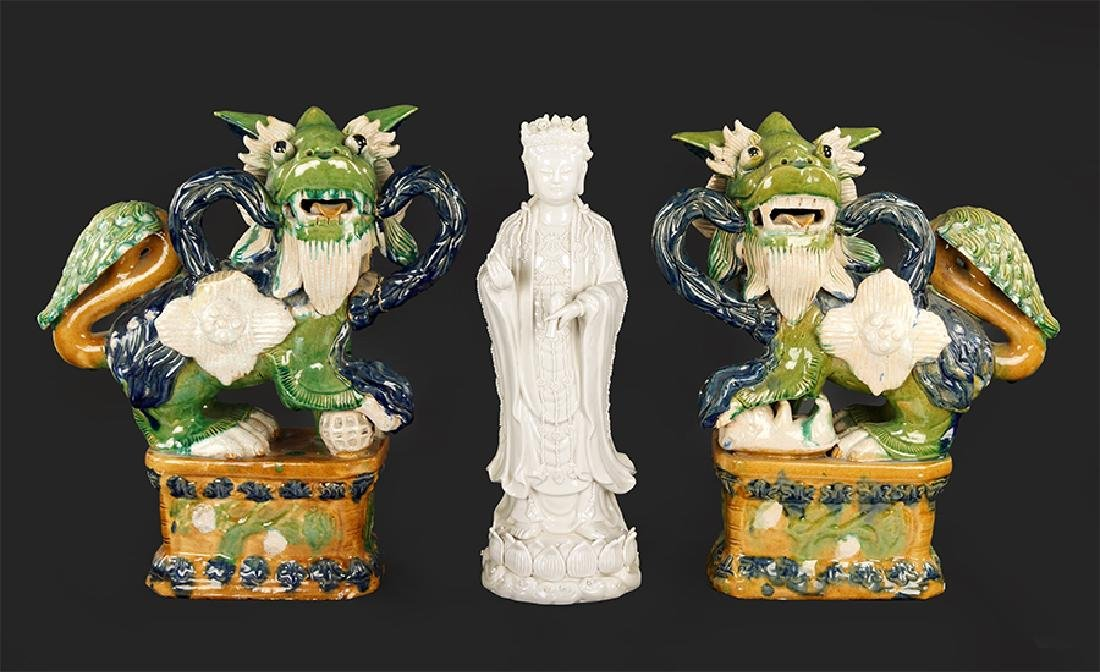 A Pair Of Chinese Ceramic Foo Lions.