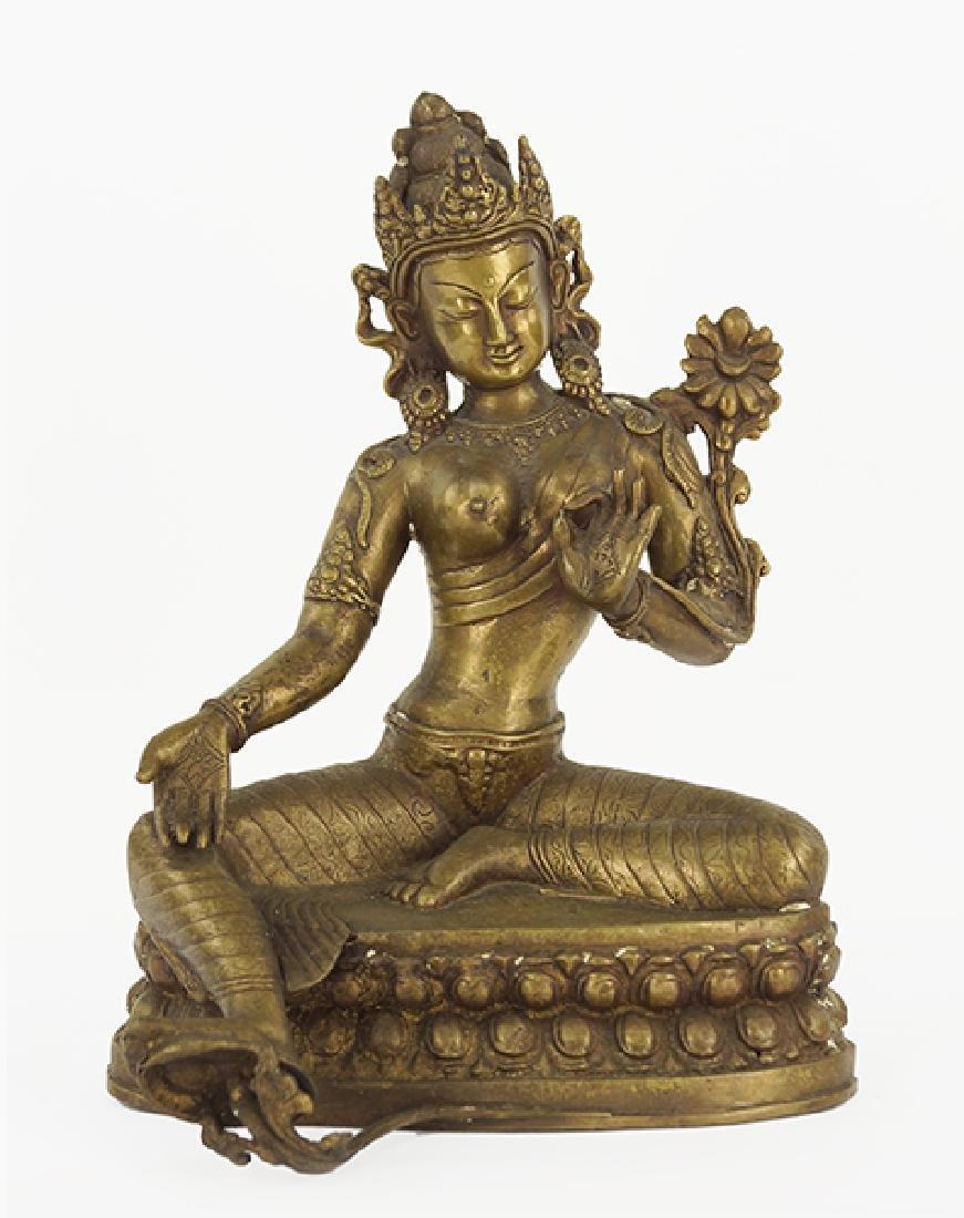A Tibetan Patinated Metal Tara Figure.