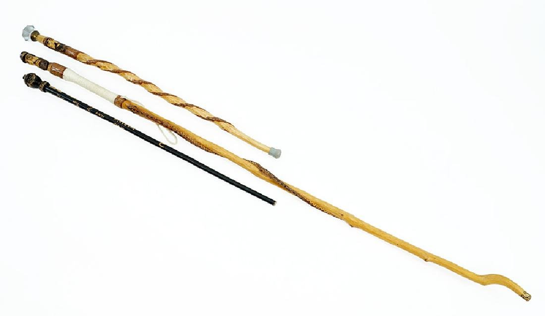 Three Folk Art Walking Sticks.