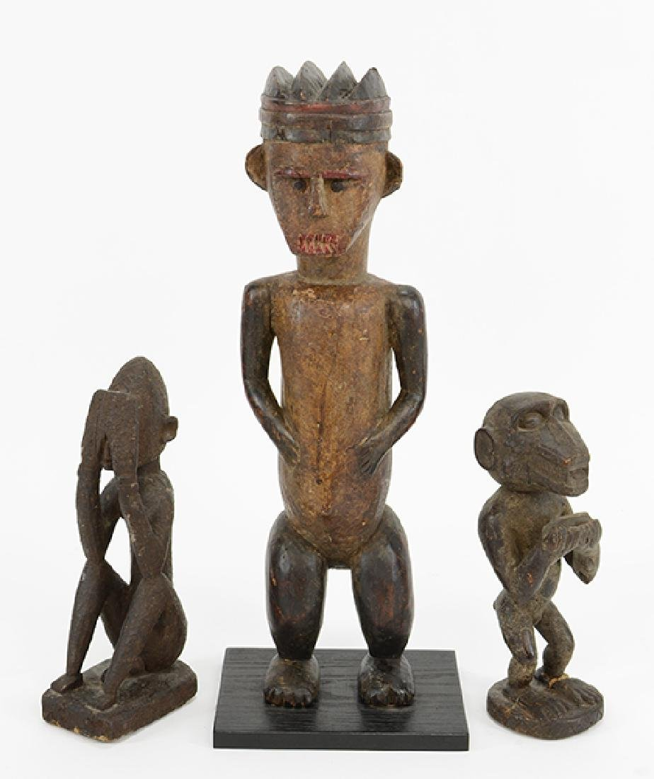Three Carved Wood African Figures.