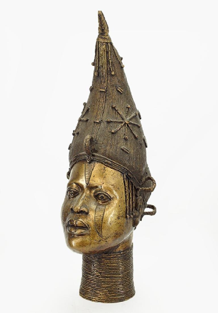 A Benin Bronze Head.