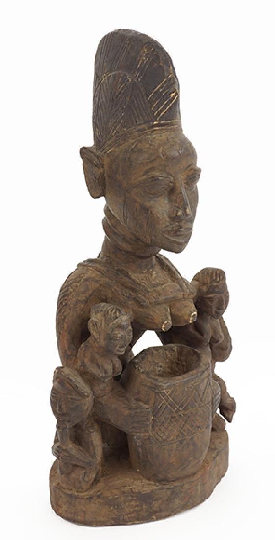 A Yoruba Figural Offering Bowl.