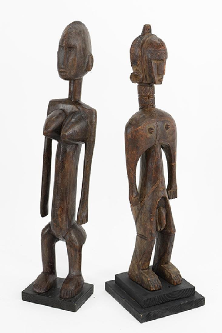 Two Carved Wood African Figures.