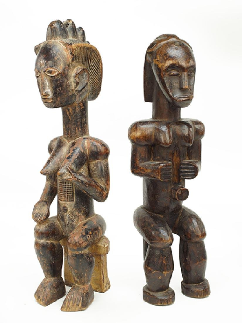 Two African Carved Wood Seated Figures.