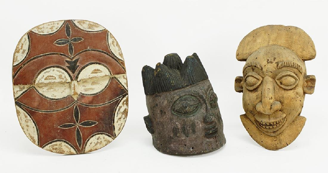 Three Carved Wood African Masks.