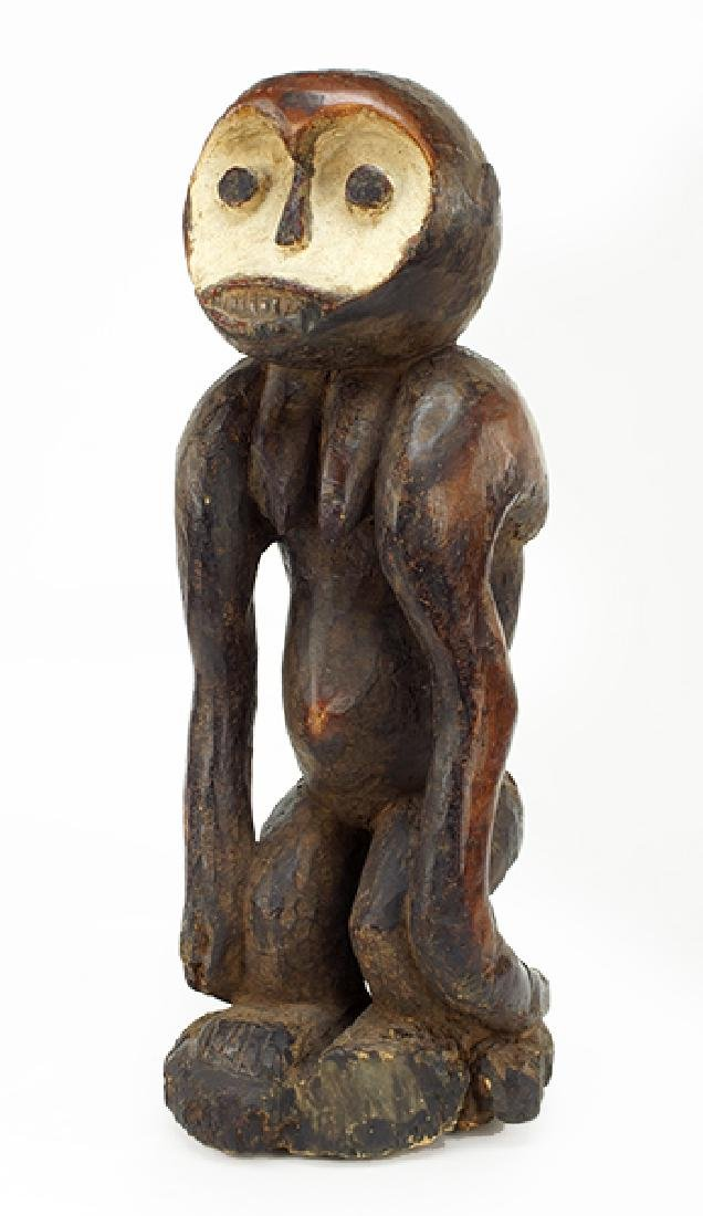 A Carved Wood African Figure.