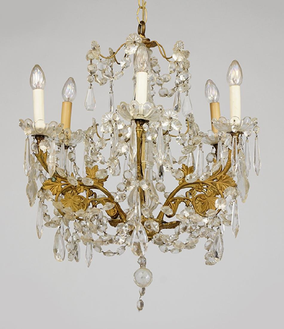 A Gilt Bronze and Crystal Six-Light Chandelier.