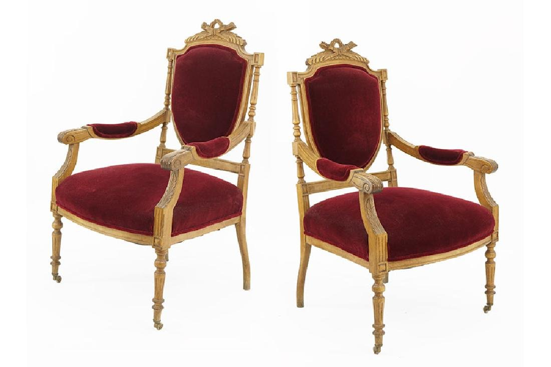 A Pair of Louis XVI Style Walnut Open Armchairs.