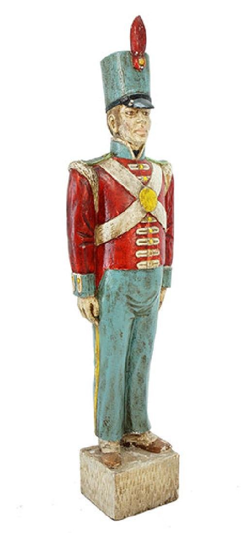A Carved and Painted Wood Soldier.