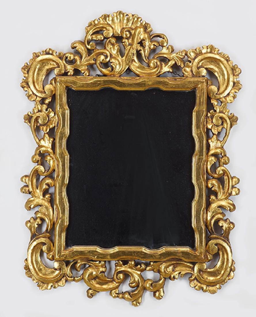 A Baroque Style Giltwood Mirror.
