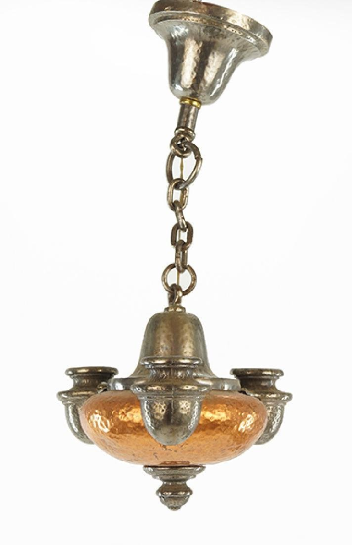 A Hammered Copper Haging Fixture.
