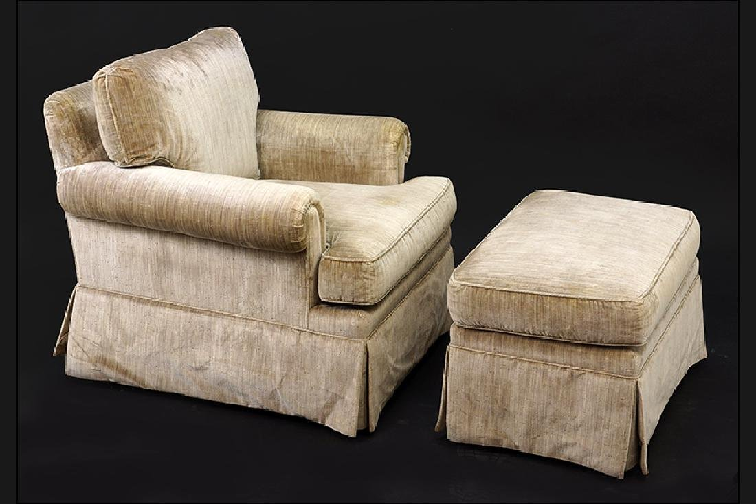 An Edward Ferrell Chair and Ottoman.