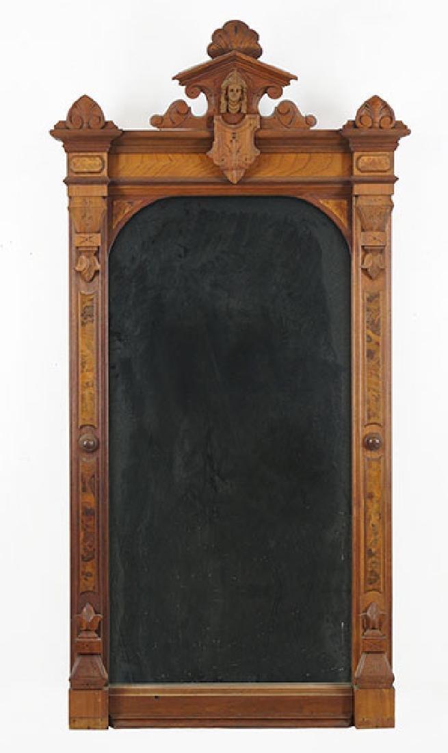 An Eastlake Carved Walnut Mirror.