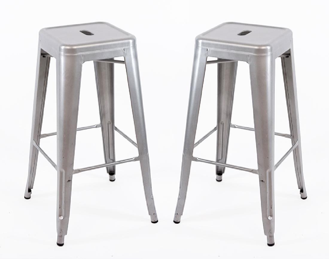 A Set Of Four Metal Stools.