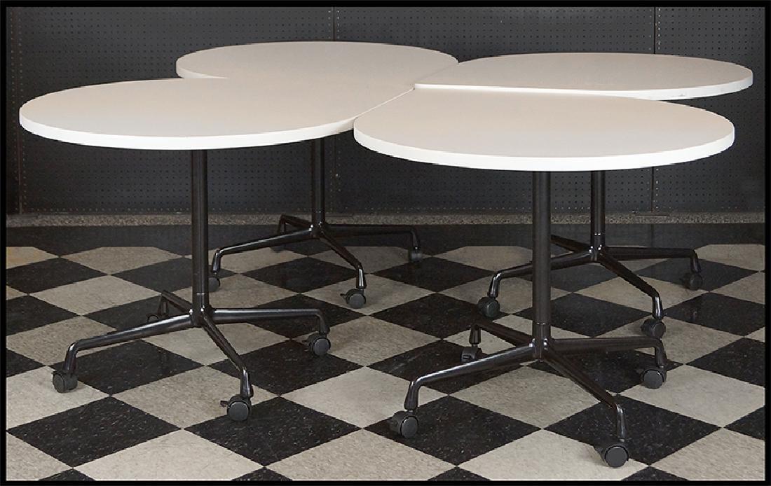 A Set Of Four Herman Miller Laminate Pedestal Tables.