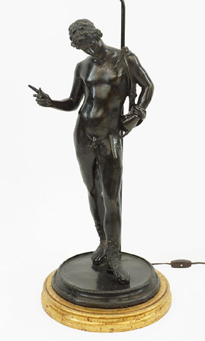 A Patinated Metal Figure Of Narcissus.