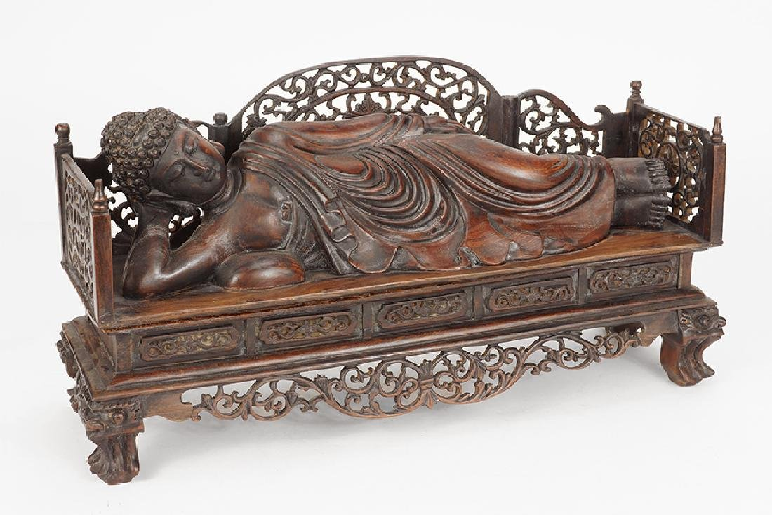 A Carved Wood Recumbent Buddha Figure.