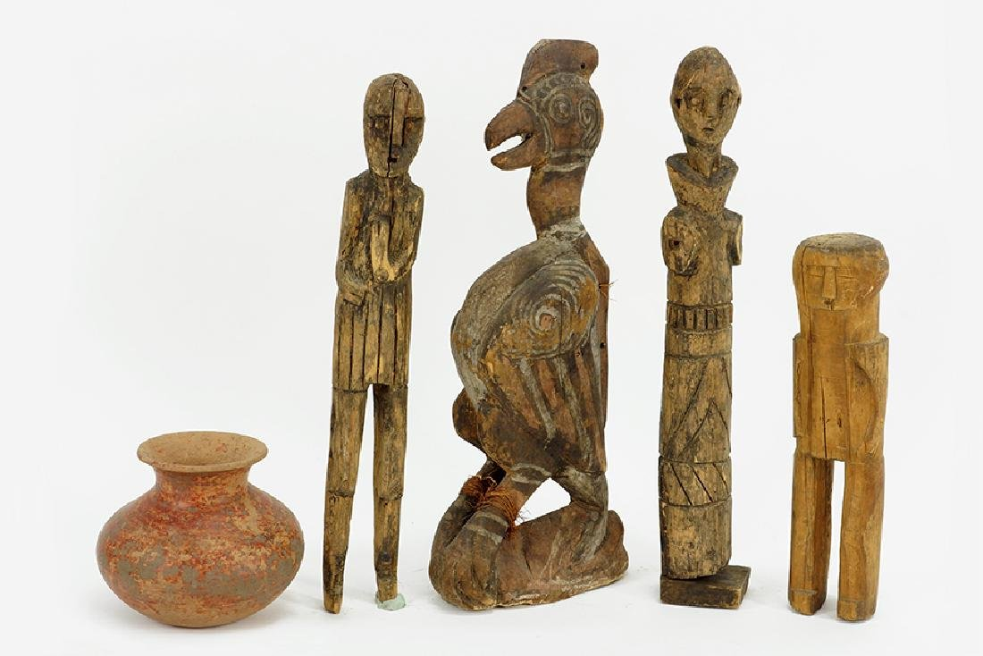 A Group Of Four Carved Wood Figures.