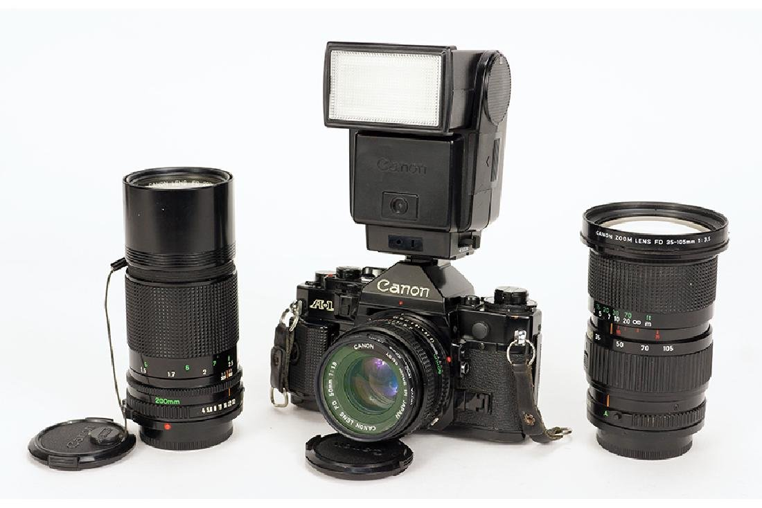 A Canon A-1 With Lenses And Accessories.
