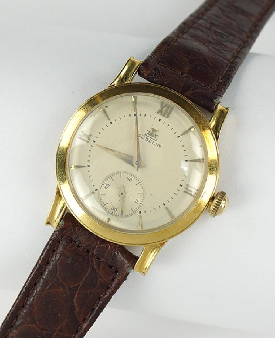 A Gubelin 18 Karat Yellow Gold Watch.