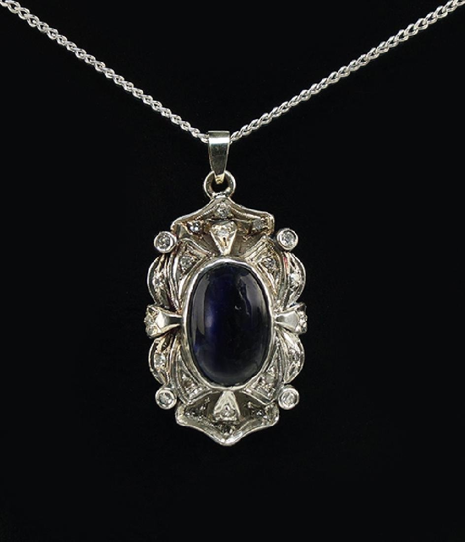 A Sapphire and Diamond Pendant Necklace.