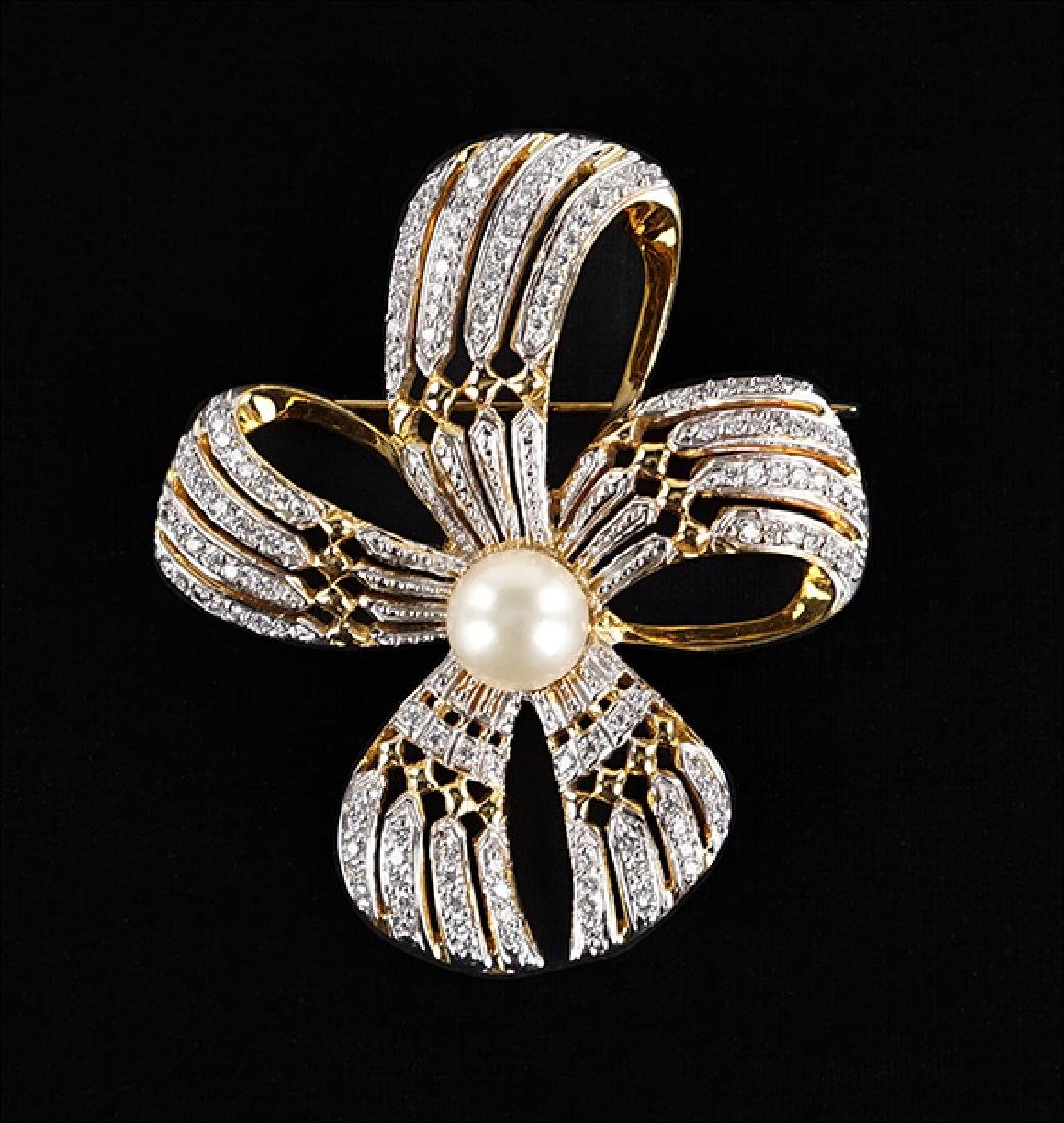 A Pearl and Diamond Brooch.