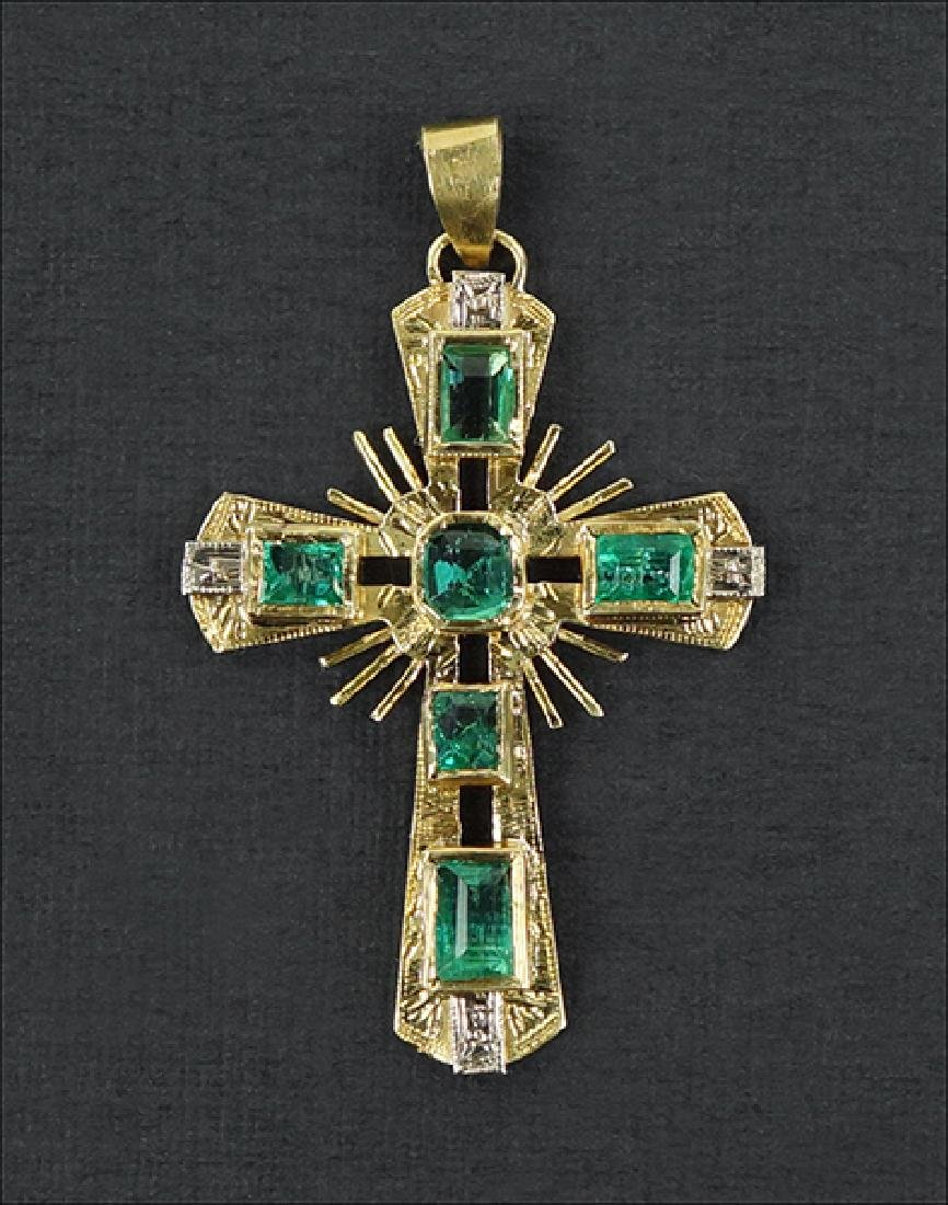 An Emerald and 18 Karat Yellow Gold Cross Pendant.