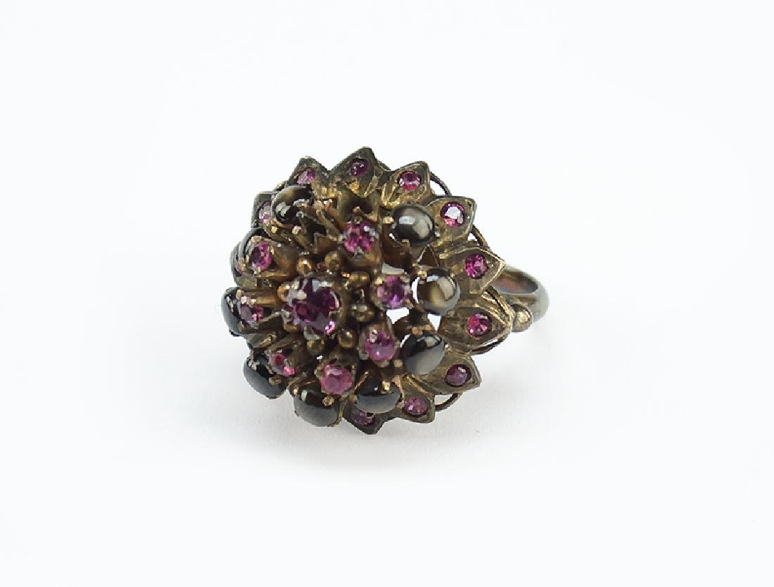 A Ruby and Black Star Sapphire Cocktail Ring.
