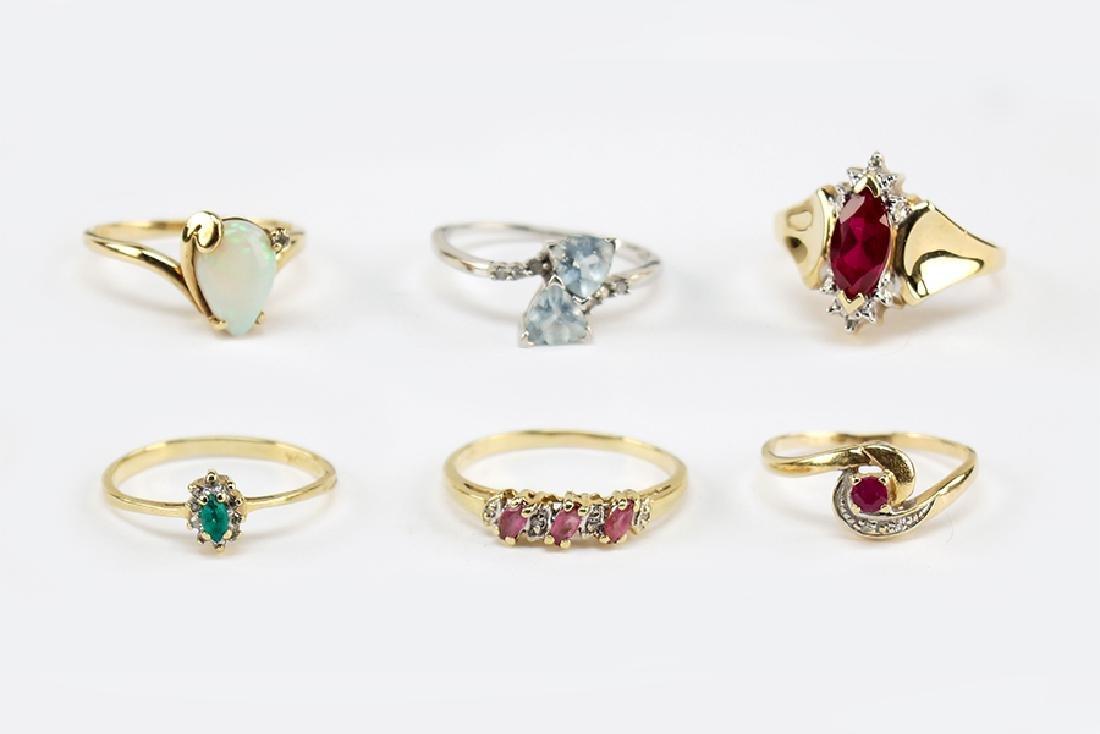 Five 10 Karat Yellow Gold Rings.