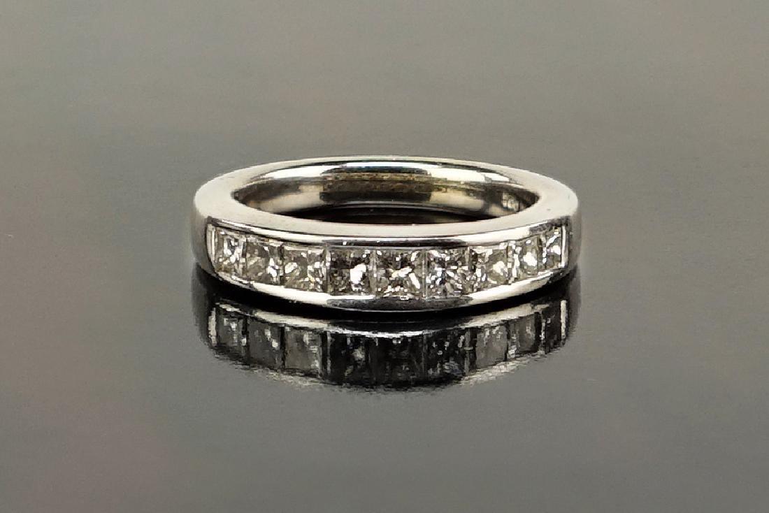 A Diamond and 14 Karat White Gold Ring.
