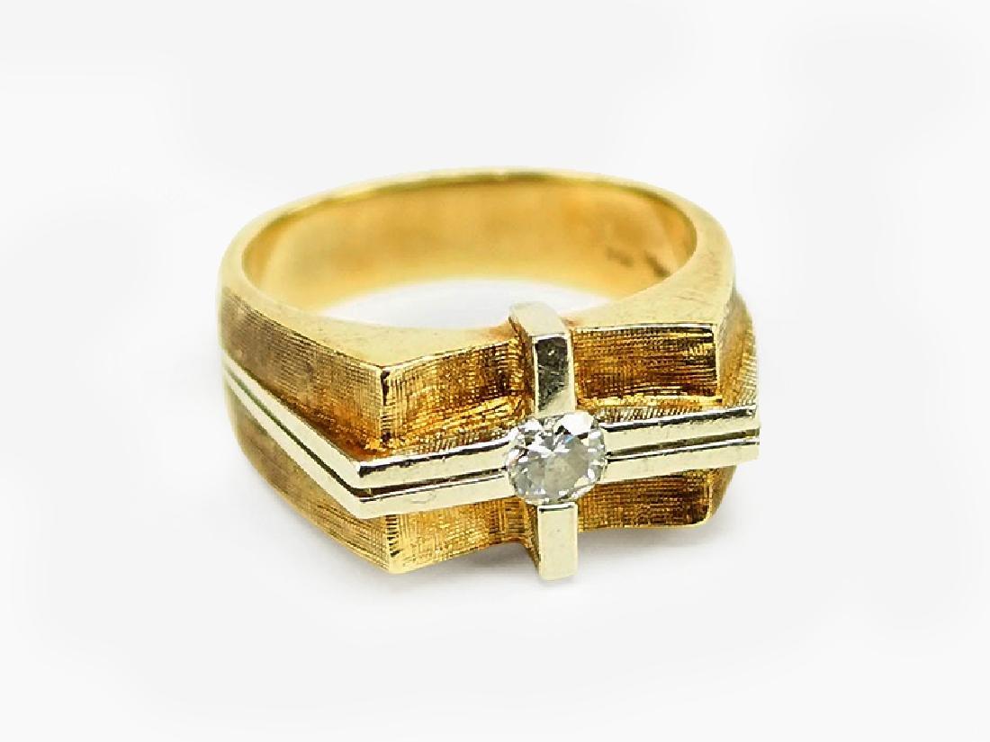 A Diamond and 14 Karat Gold Ring.