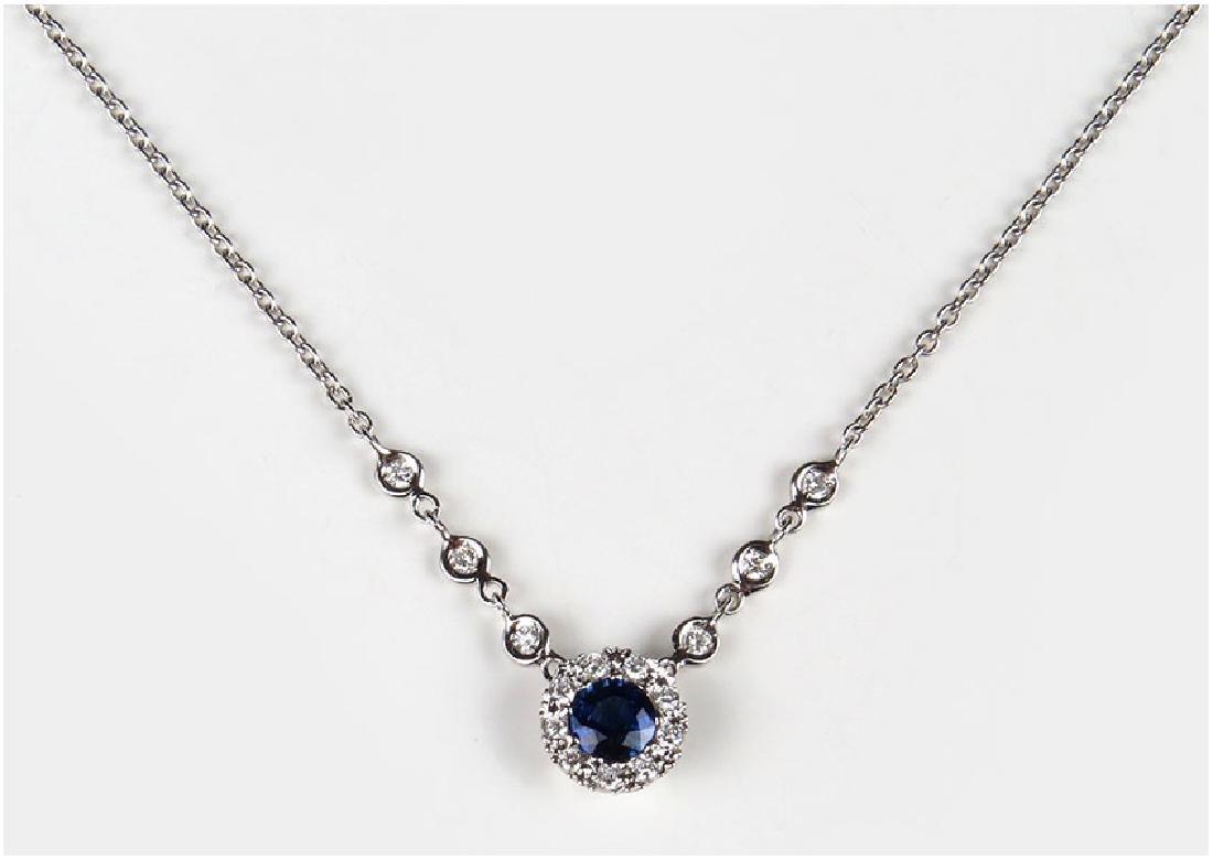 A Diamond, Sapphire and 18 Karat White Gold Necklace.