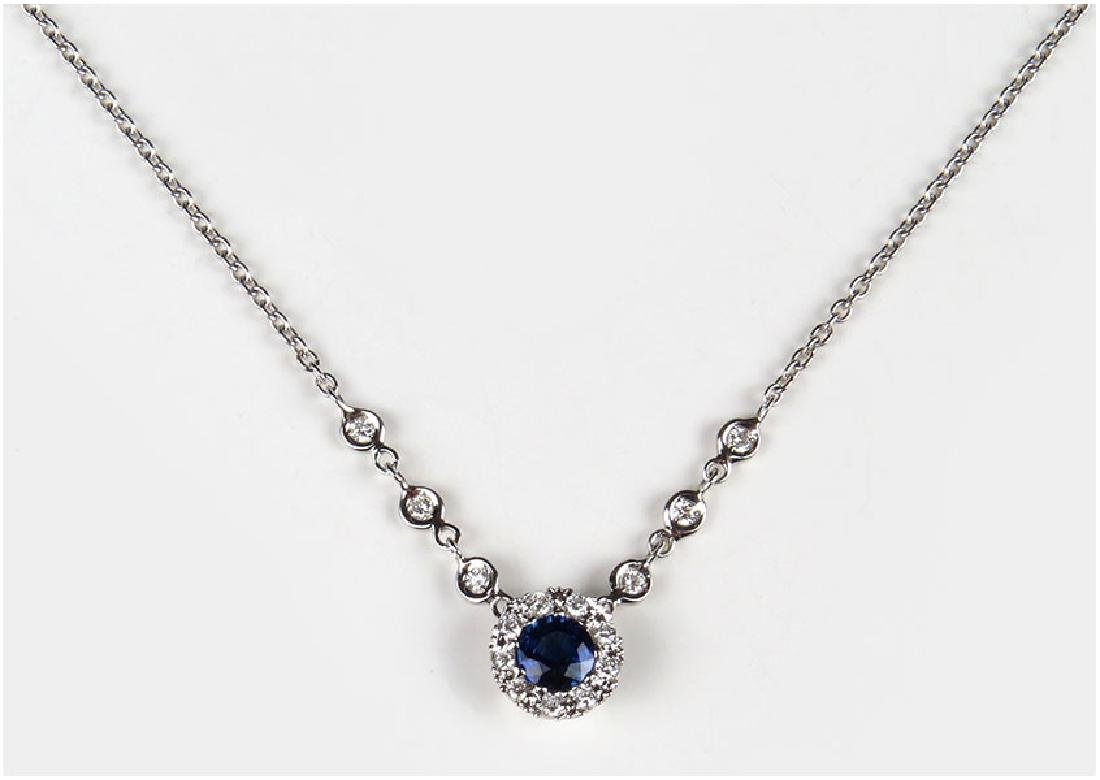 A Diamond, Sapphire and 18 Karat White Gold Necklace.
