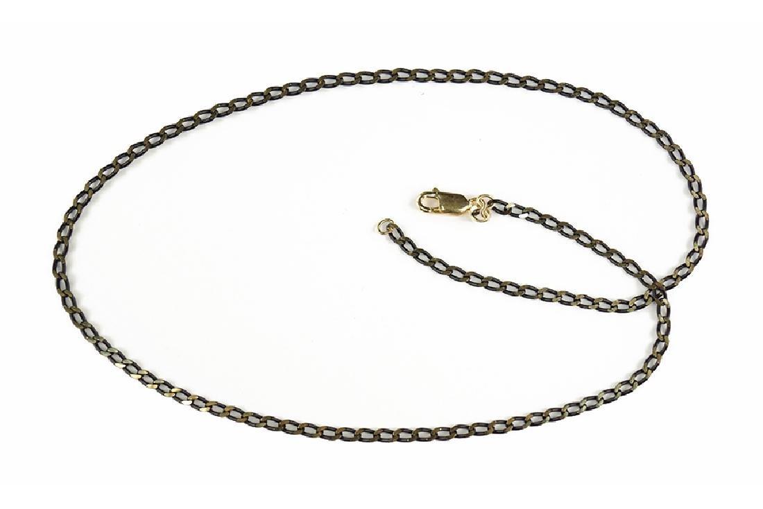 An 18 Karat Gold Necklace.