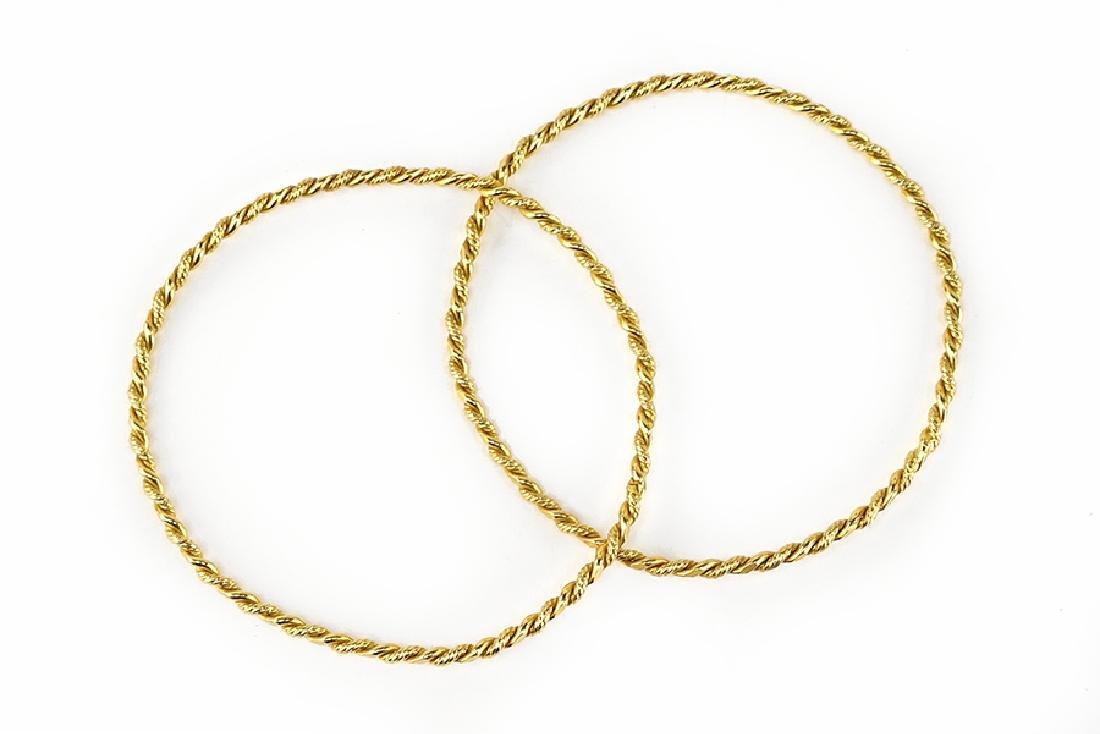 A Pair of Gold Bracelets.