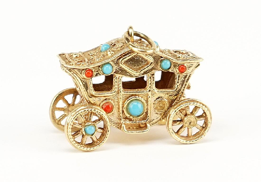 A Gold Carriage Charm.