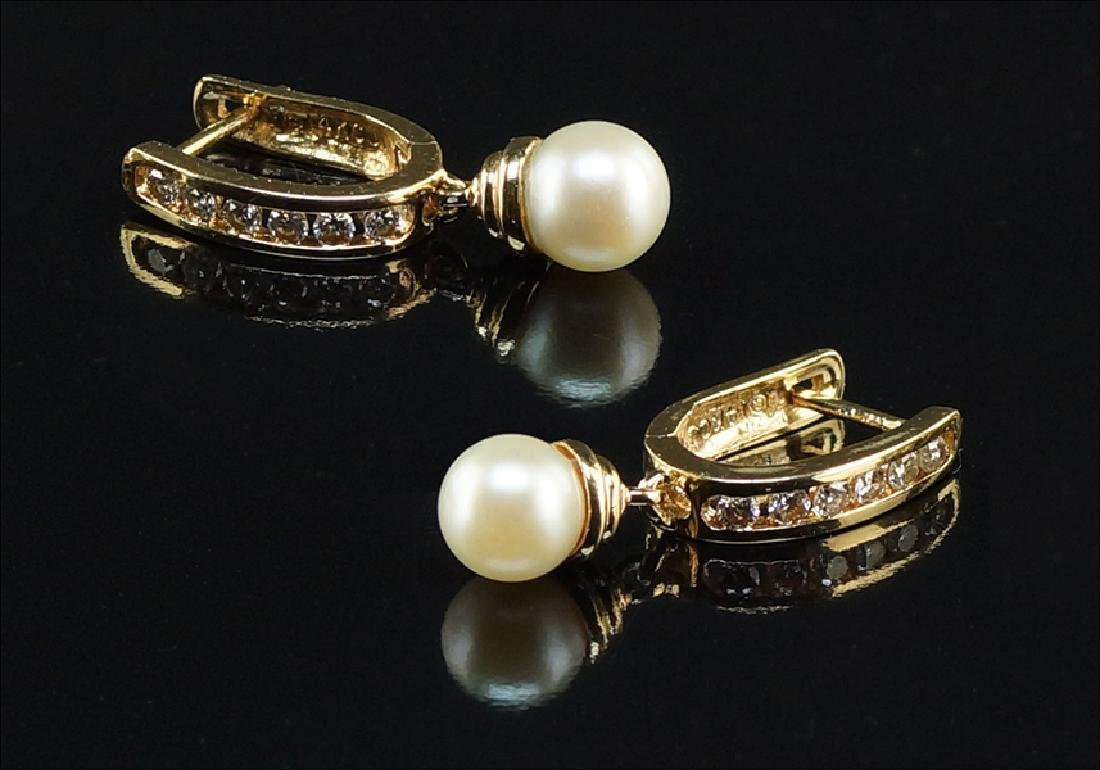 A Pair of Pearl and Diamond Earrings.