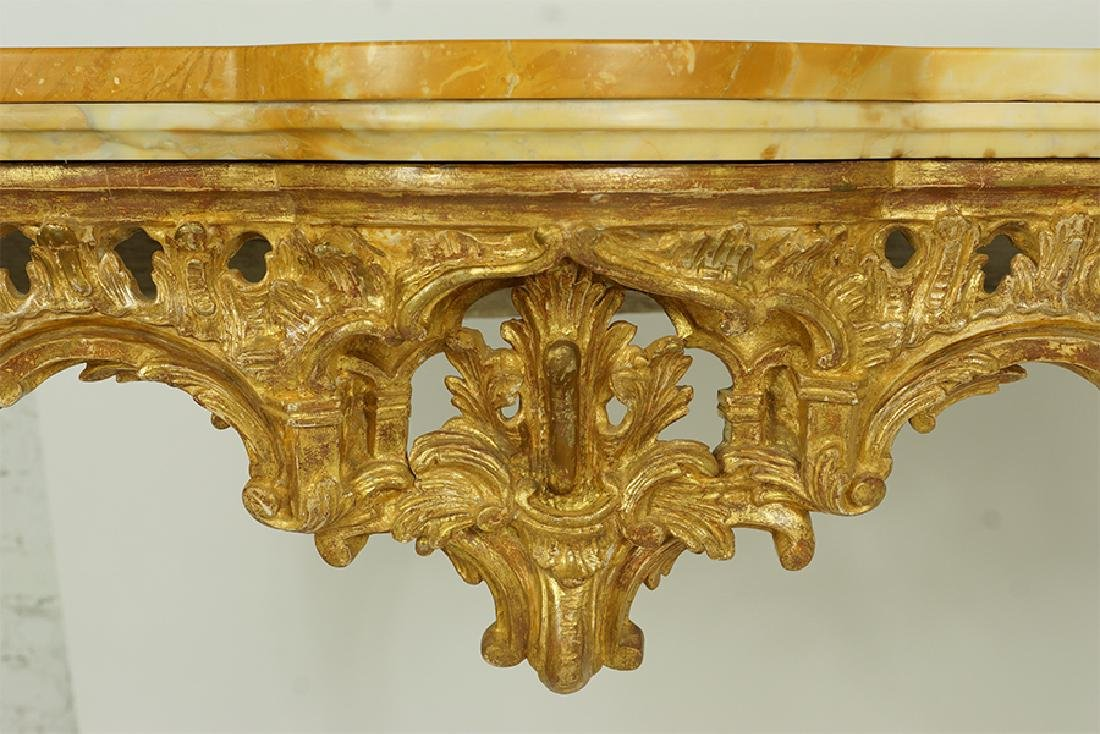 A George III Rococo Giltwood Console Table. - 2