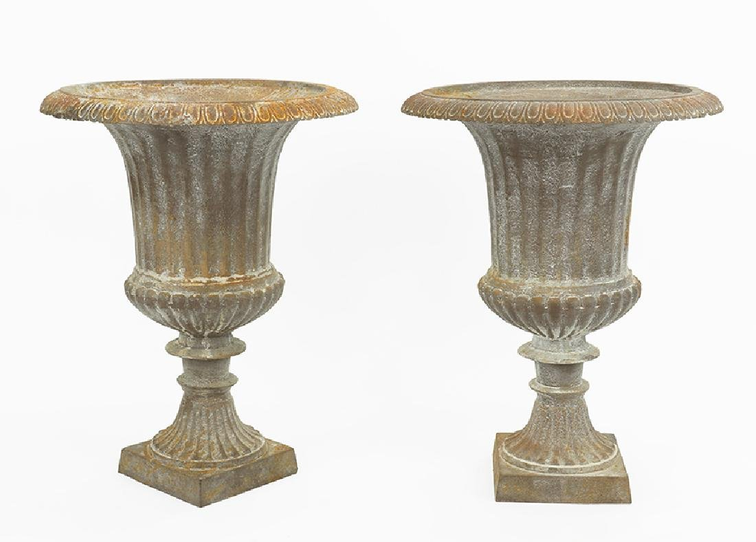 A Pair of Patinated Metal Urns.
