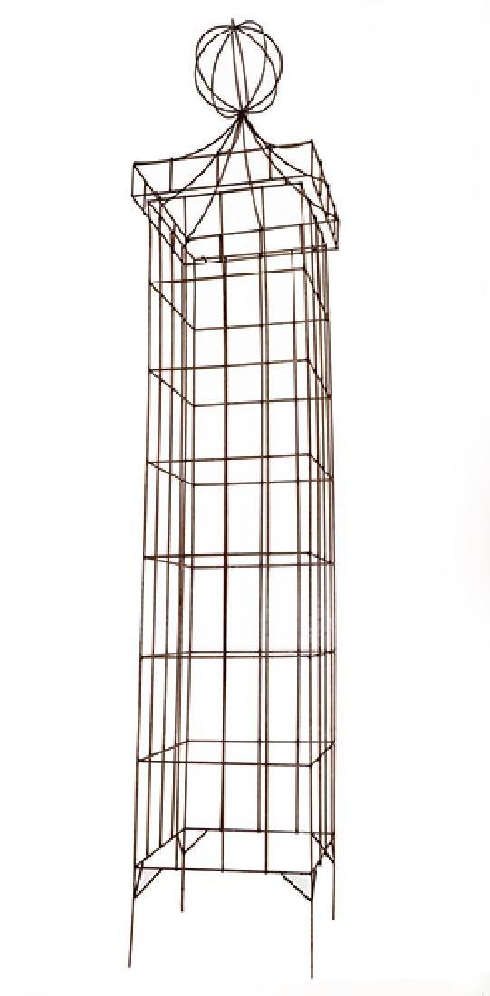 A Monumental Patinated Metal Trelis.