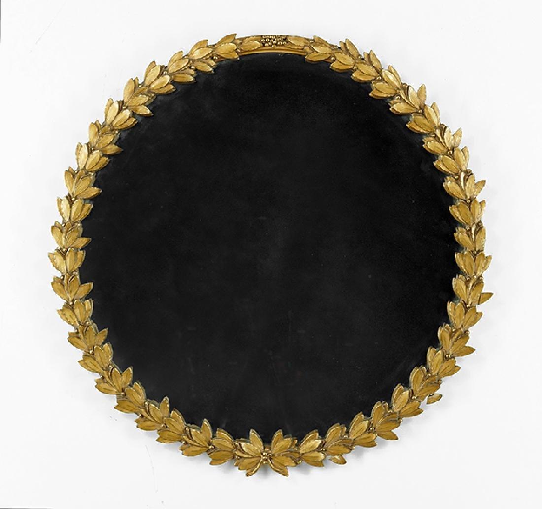 A Round Giltwood Mirror.