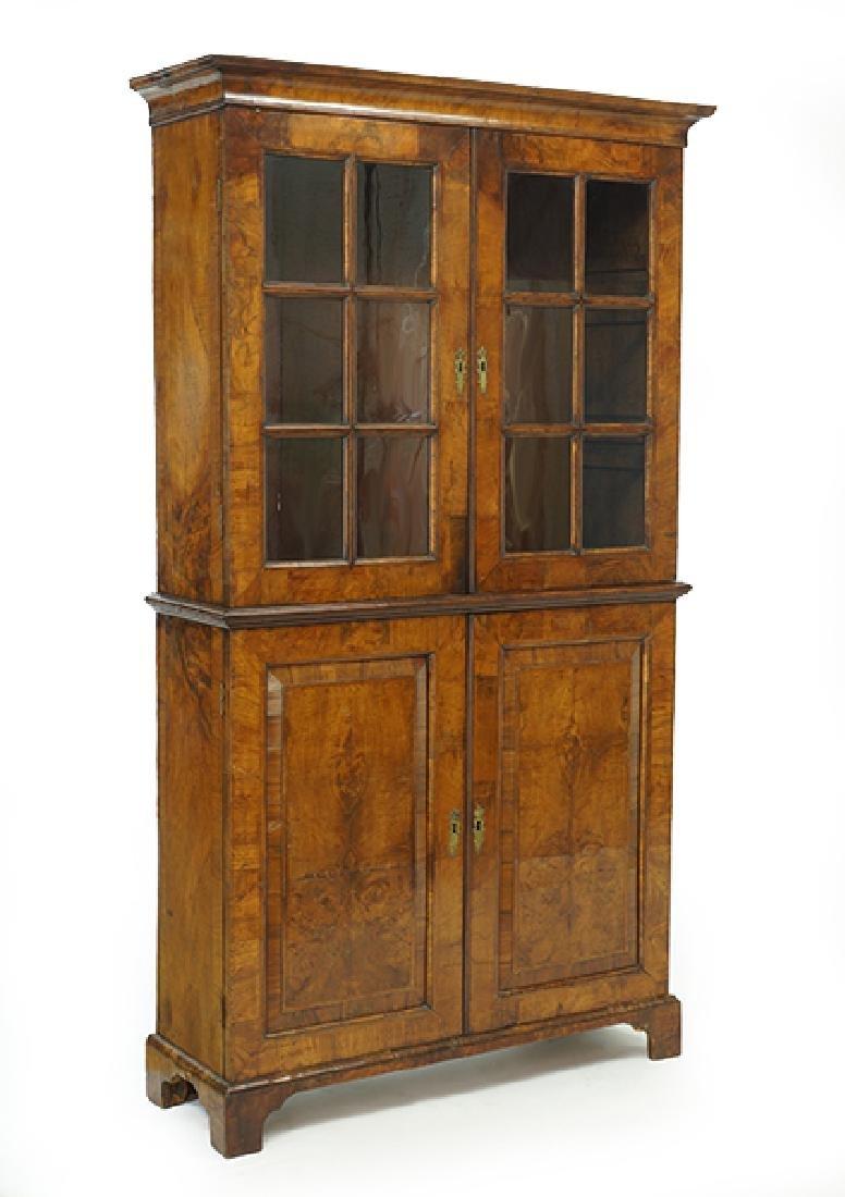A George I Walnut Veneered Bookcase Cabinet.